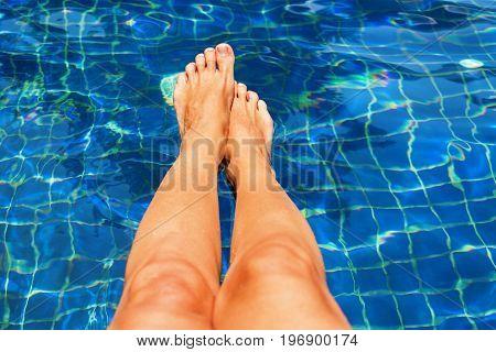 Beautiful Suntan Female Legs In Swimming Pool