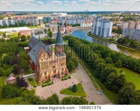 Aerial cityscape of historical city centre at sunny summer day with white clouds in the blue sky. Kaliningrad, Russia