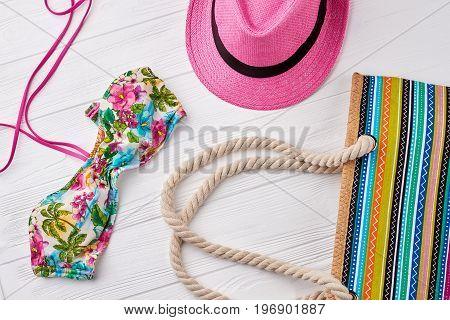 Summer beach fashion clothing set. Pink hat, striped handbag, bra. Summer vacation concept.