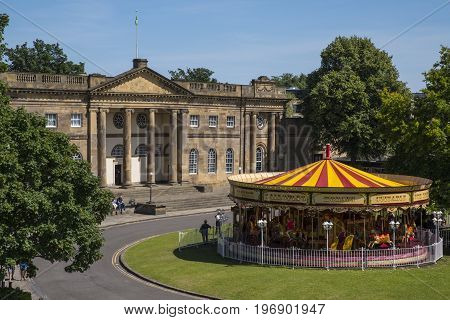 A view of the York Castle Museum and a Merry-go-round in the historic city of York England.