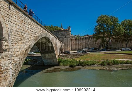Avignon, France - July 06, 2016. View of the arches of the Pont d'Avignon (bridge), with the historic center of the charming Avignon in the background. Vaucluse department, Provence-Alpes-Côte d'Azur region, southeastern France