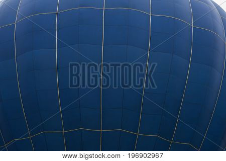 Small part of the big ball outside of a blue hot air balloon. With place for your text, for background use