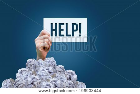A Sign Saying Help In A Pile Of Garbage.
