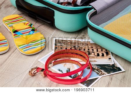 Attributes of summer rest, open suitcase. Positive vacation with colored accessories.