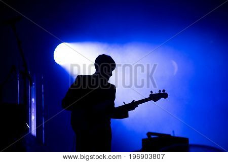 Silhouette Of A Guitar Player On The Stage