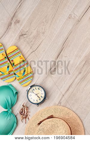 Summer beach clothing stuff, top view. Seaside accessories on wooden space.