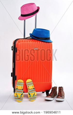 Beach accessories, suitcase, white background. Be in trend with stylish summer items. Fashionable things for travelling.