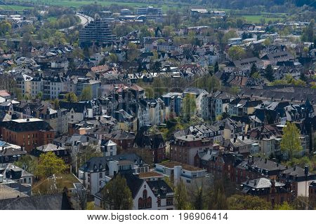 MARBURG GERMANY - APRIL 18 2015: The new and the old part of the city from the surrounding hills. Marburg is a university town in the German federal state (Bundesland) of Hessen.