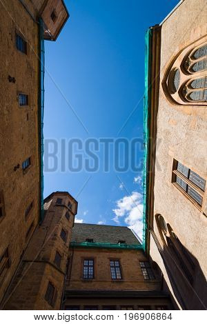 MARBURG GERMANY - APRIL 18 2015: View on a blue sky from the yard Marburger Schloss (Marburg castle). Marburger Schloss is the first residence of Landgraviate of Hesse.