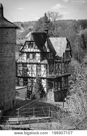 MARBURG GERMANY - APRIL 18 2015: Utility homes in Marburger Schloss (Marburg castle) is the first residence of Landgraviate of Hesse. Black and white.