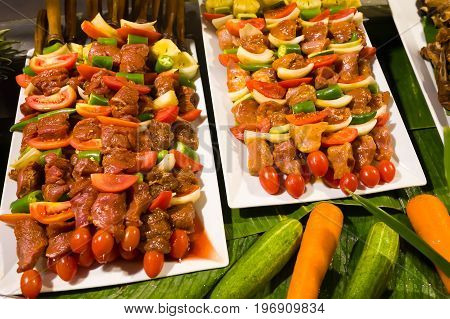 Shish kebab with meat and vegetables in the Asian street cafe