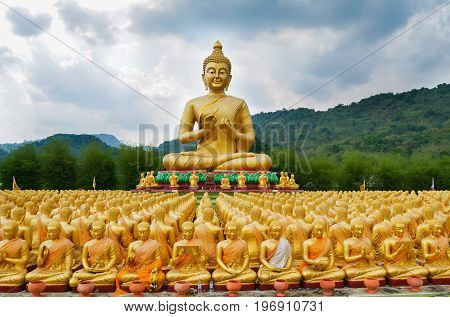 Big Golden Buddha Statue surrounding by small Buddha Statues at Buddha Makabucha Memorial park Nakornnayok Thailand