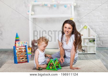 Mother And Her Son Play Together Indoor