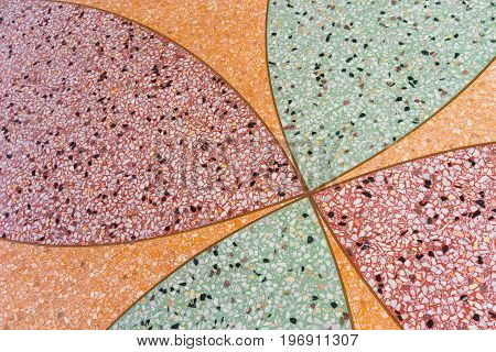 Terrazzo Floor background. Terrazzo is a composite material, poured in place or precast, which is used for floor and wall treatments. It consists of chips of marble, quartz, granite, glass, or other suitable material, poured with a cementitious binder (fo