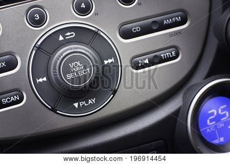 Controller button of media audio in car interior for radio and audio volume adjustment. selective focus. Automotive part concept.