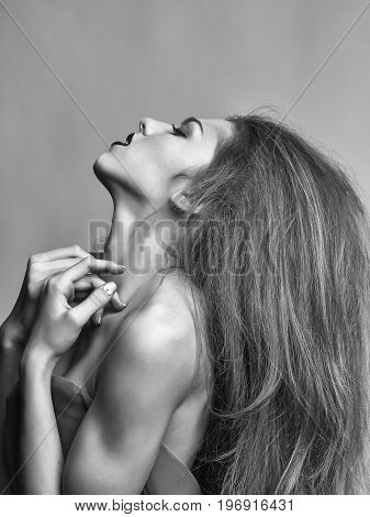 Lady With Long Hair And Bare Shoulder