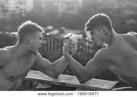 men or bodybuilders athletes with sexy muscular torsos with six packs abs biceps triceps wrestling outdoor black and white poster