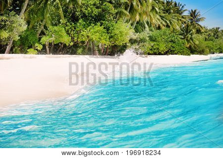 View of sea waves and beautiful beach at tropical resort