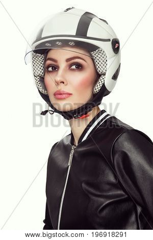 Vintage style portrait of young beautiful woman with stylish make-up in biker helmet
