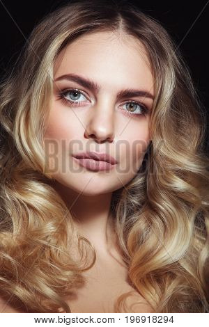 Young beautiful woman with clean make-up and blonde curly hair