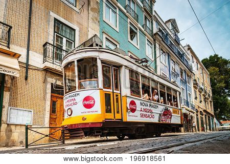 Editorial: 8Th June 2017: Lisbon, Portugal:  Classical Colorized Touristic Tram On The Street, Persp
