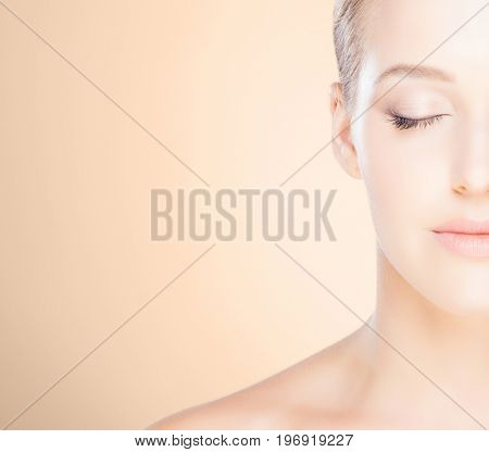 Beautiful face of a young woman. Plastic surgery concept.
