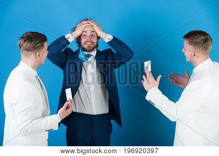 Businessman Clutching Head With Despair