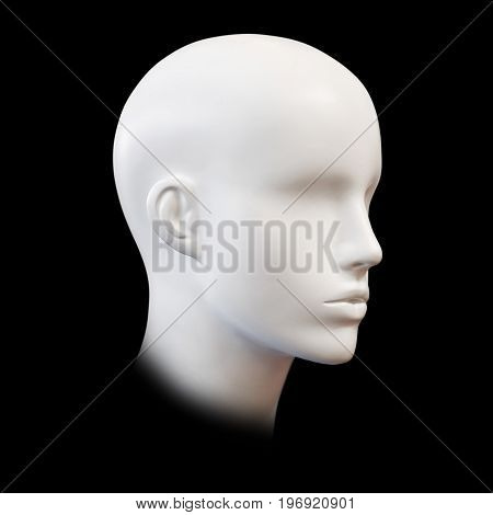 Closeup plastic mannequin heads isolated on black background.