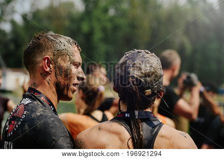 Men And Women Overcome The Water Mud Barrier During The Power Race Legion Run, Held In Kiev