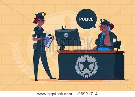 Two African American Police Women Working On Computer Wearing Uniform Female Guards On Blue Bricks Background Flat Vector Illustration