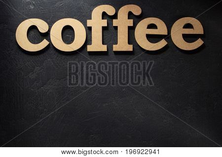coffee wooden letters on black background