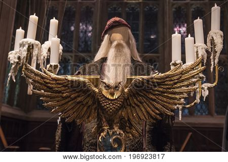 LEAVESDEN UK - JUNE 19TH 2017: The golden Owl Lecturn on the set of the Great Hall at Hogwarts at the Making of Harry Potter studio tour at the Warner Bros studios in Leavesden UK on 19th June 2017.