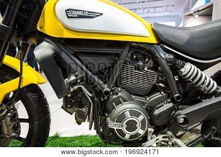 BERLIN - MAY 02 2015: Showroom. Detail of the engine and the fuel tank motorcycle Ducati Scrambler Classic. Produced since 2015.