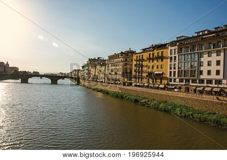 Florence, Italy - May 14, 2013. Overview of the river Arno, bridge and buildings at sunset. In the city of Florence, the famous and amazing capital of the Italian Renaissance. Located in the Tuscany region