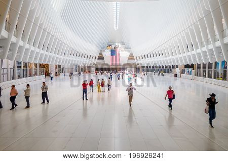 NEW YORK, USA - MAY 05, 2017: Crowds of passengers pass under the distinctive architectural, form of the Oculus transportation hub at World Trade Center, by architect Santiago Calatrava in New York Usa.
