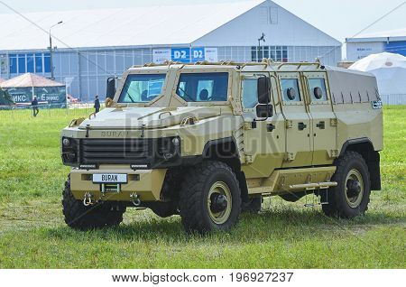 ZHUKOVSKY, RUSSIA, JUL. 21, 2017: Exhibition MAKS 2017. New modern powerful Russian armored vehicle of sand color. Russian military cars for troopers. Utility armoured car transformer concept