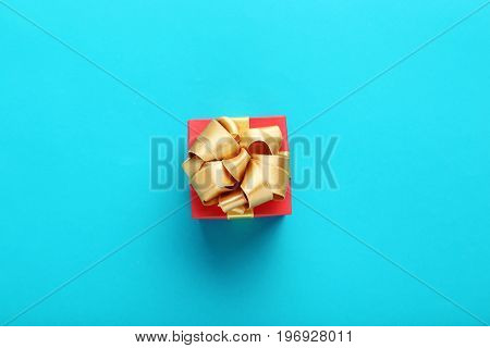 Gift Box With Ribbon On Blue Background