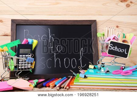 Shopping Cart With Stationery And Black Frame With Inscription Back To School