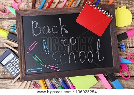 Inscription Back To School On Wooden Frame With Stationery