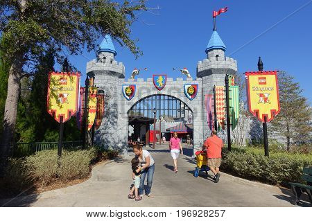 HOUSTON, USA - JANUARY 12, 2017: Unidentified people walking near of big castle entrance in Legoland, as touristic place. Legoland is a theme park based on the popular LEGO brand of building toys.