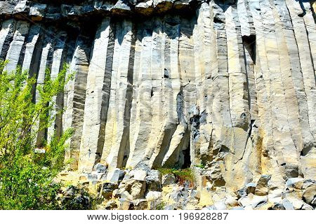 Basalt columns rocks in Racos, Transylvania, volcanic rock outcrops in the form of columnar basalt located in Racos, Romania. In an old roman abandoned career. It is a national protected area.