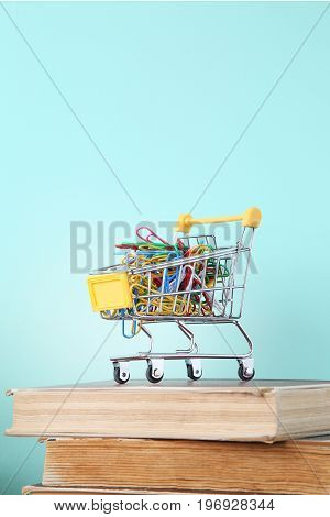Shopping cart with the paperclips on books