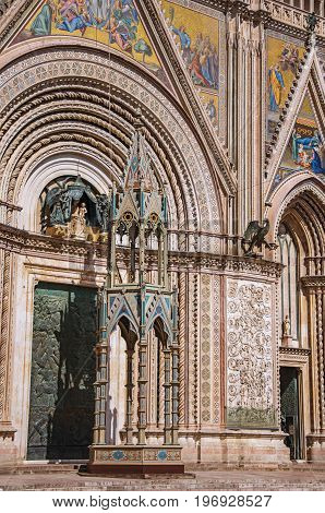 Facade details of the opulent and monumental Orvieto Cathedral (Duomo) on a sunny day in Orvieto, a pleasant and well preserved medieval town. Located in Umbria, central Italy