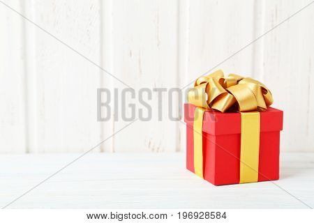 Gift Box With Ribbon On White Wooden Table
