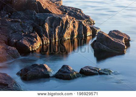 Rocks Of Stony Coast In Lake Water