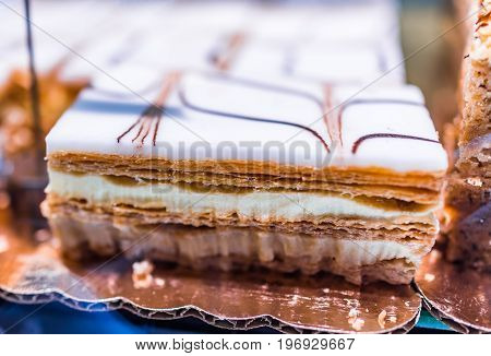 Puff Pastry Napoleon Cake In Bakery With Whipped Cream Layers