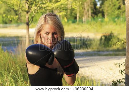 A young sporty girl with boxing gloves