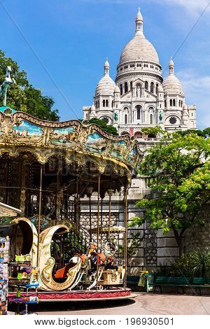 View of Basilica of the Sacred Heart of Paris. Sacre Coeur Basilica is a roman catholic church and popular landmark. The basilica is located at the summit of the butte Montmartre. Paris, France