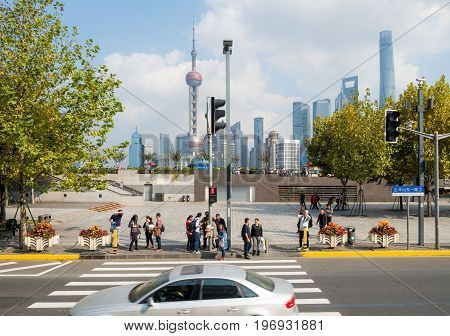 Shanghai, China - Nov 6, 2016: Along The Bund in a bus on Zhongshan Road East at a pedestrian crossing. Image overlooks the Pudong District, across the Huangpu River.