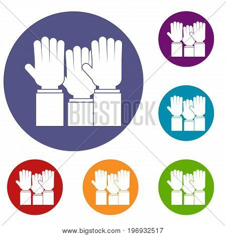 Different people hands raised up icons set in flat circle red, blue and green color for web